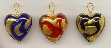 Murano glass pendants hearts crosses stars millefiori fish snakes yellow gold foil murano heart pendants with colored swirls each murano glass heart is handmade with 24 karat gold foil and swirls of color mozeypictures Choice Image